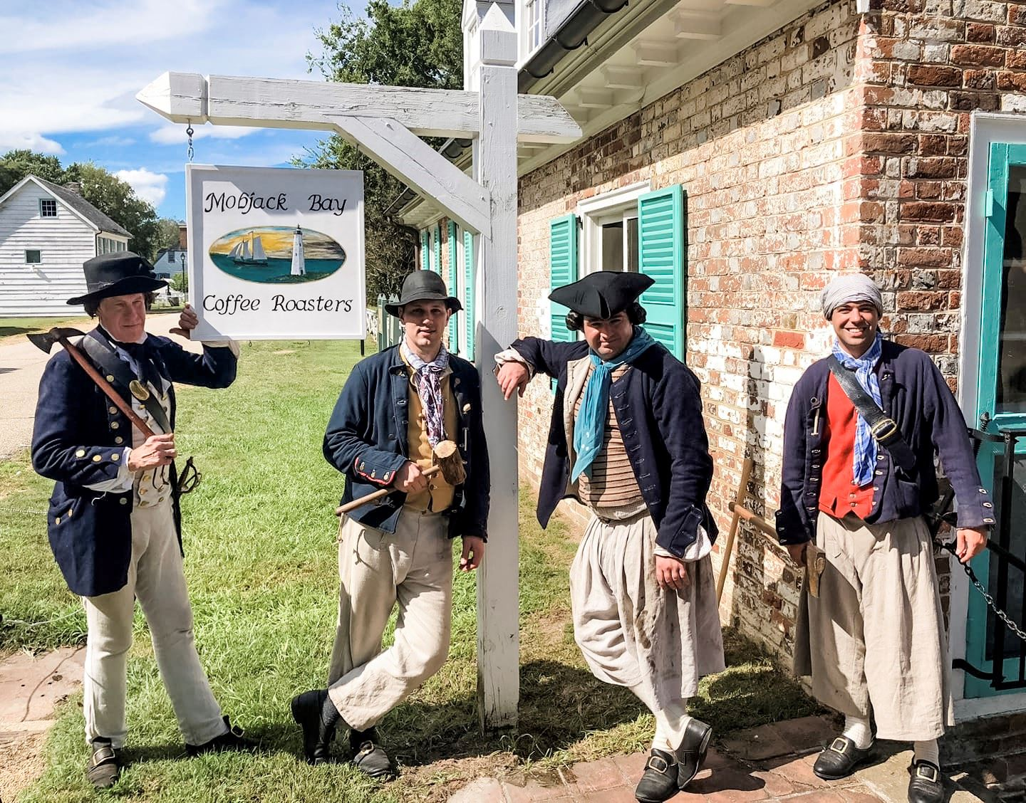 Reenactors posing outside Mobjack Bay Cofee Roasters