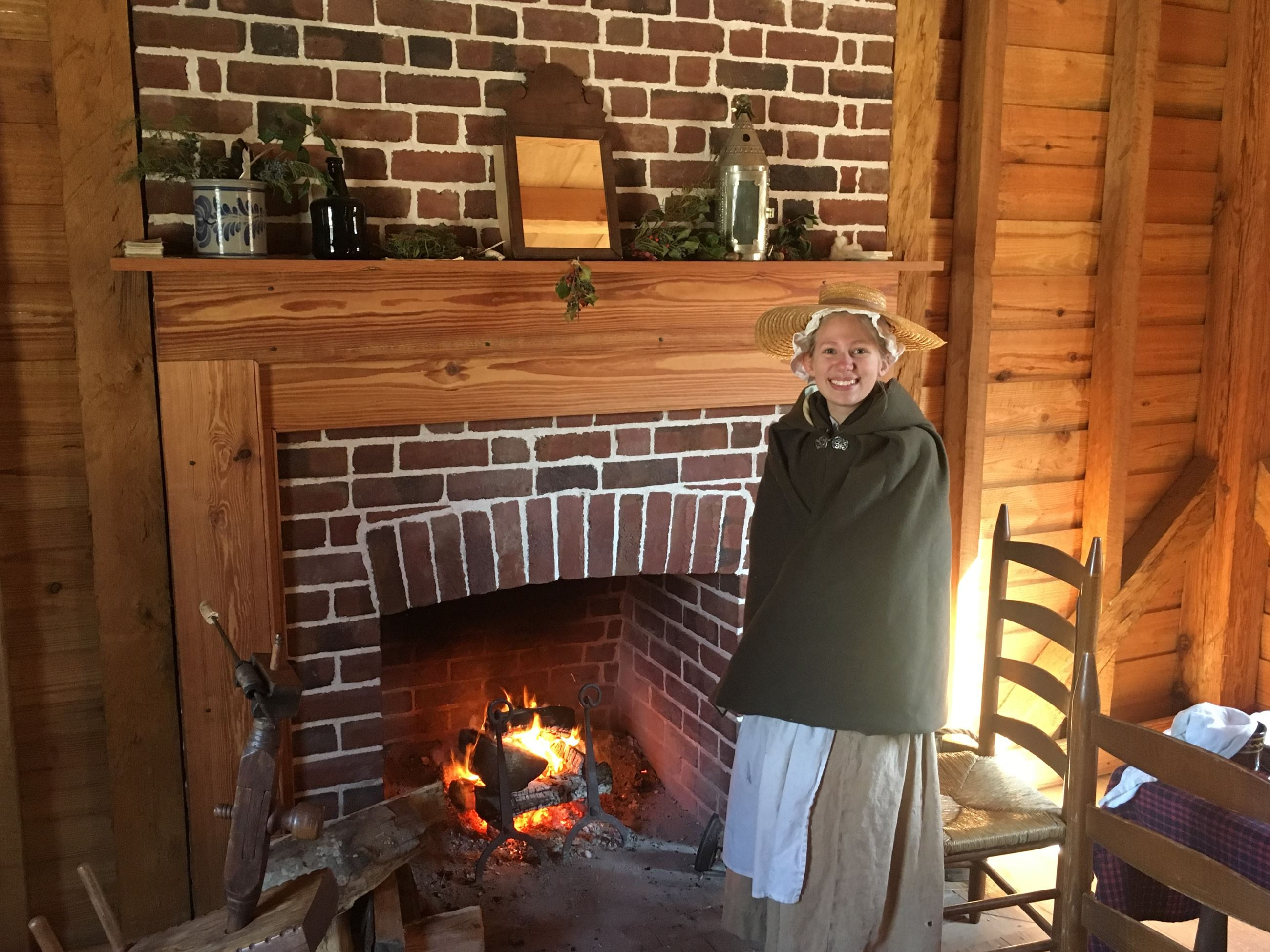 Christmastide in Virginia colonial woman warming by the fire