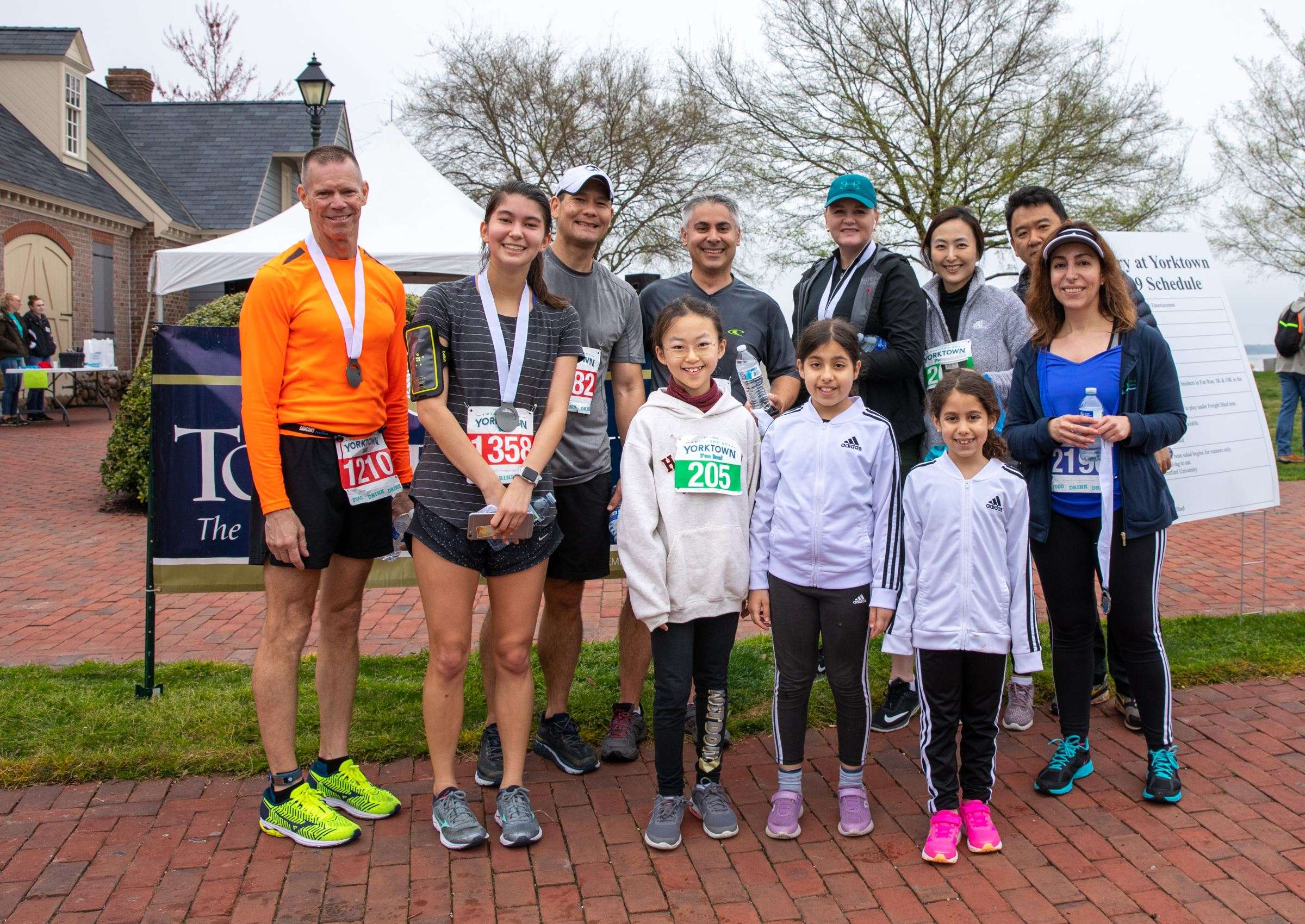 Family posing together after Victory at Yorktown Race