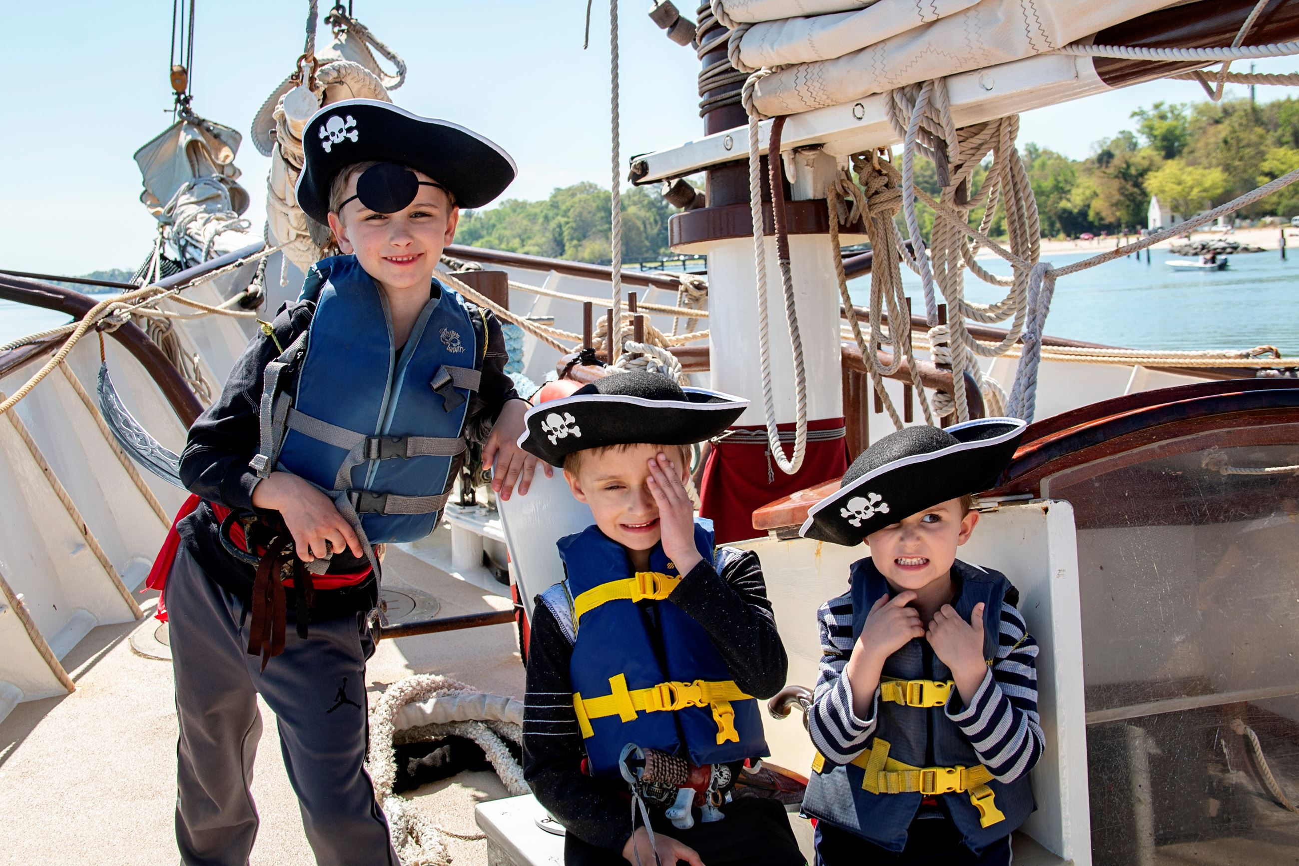 Kids posing with eye patches on Pirate Adventure Cruise
