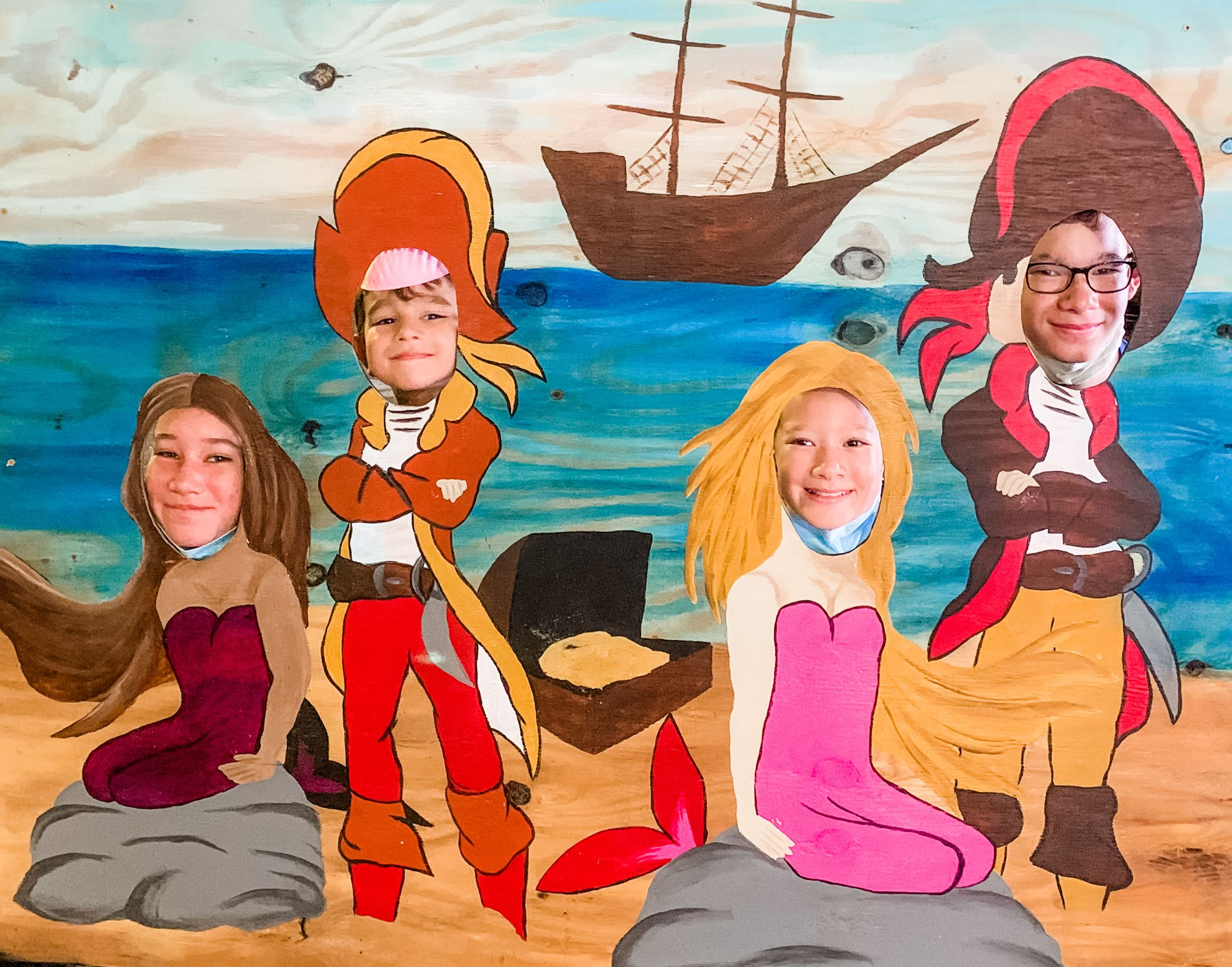 Pirate ship cutout with family posing