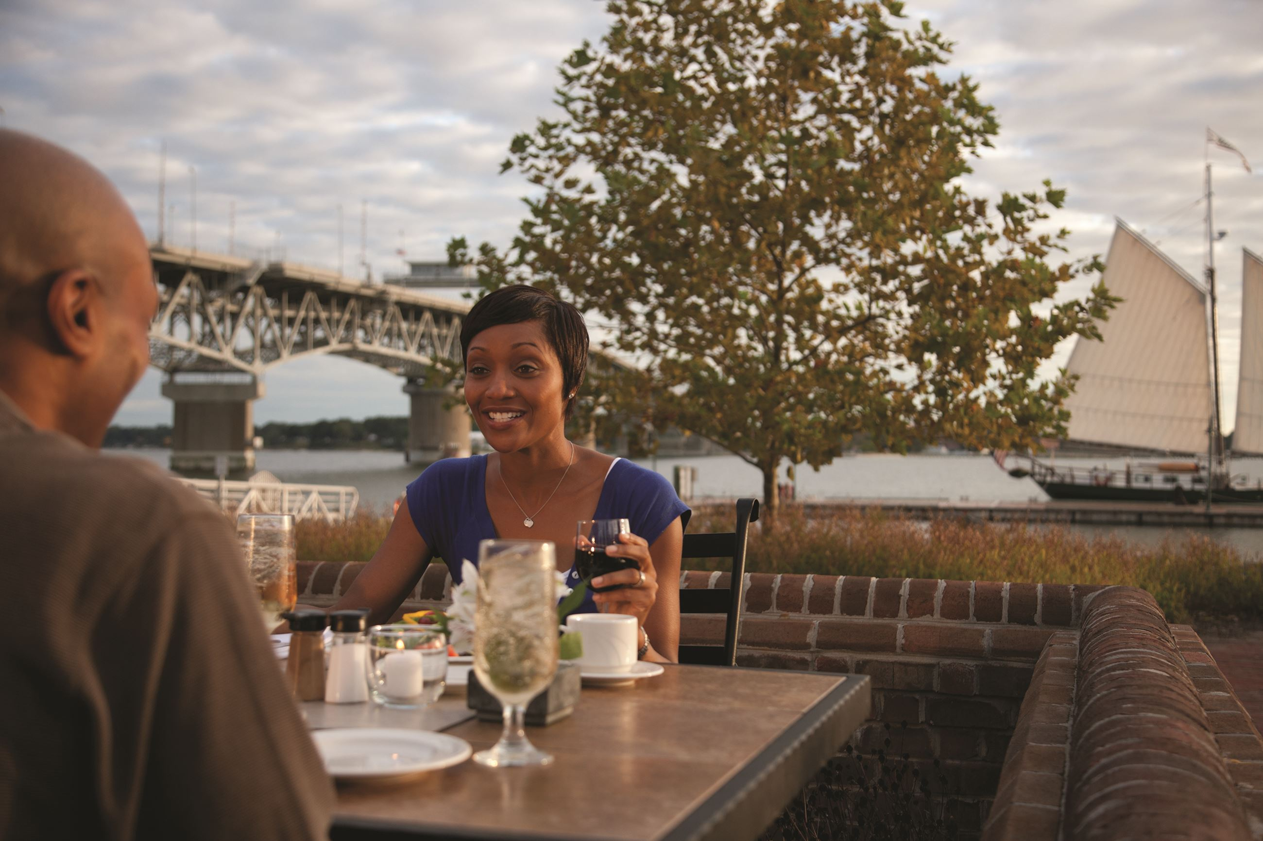 Riverwalk Outdoor Dining with View of Coleman Bridge